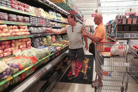 Michael Tapia and David Schmoll shop at the Grocery Outlet Bargain Market store in downtown Palm Springs on Aug. 28, 2019.