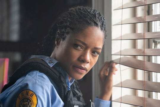 "Naomie Harris plays a a cop on the run in ""Black and Blue."""
