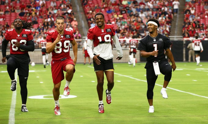 Cardinals rookies Andy Isabella (89, KeeSean Johnson (19) and Kyler Murray (1) warm up during a training camp practice on July 25.