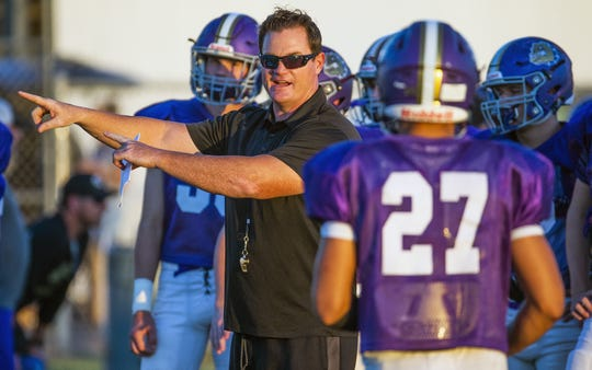 Queen Creek head coach Joe Germaine instructs his team during a practice Aug. 27.