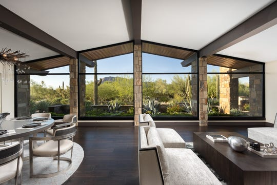 The $3.33 million Paradise Valley mansion, sold by James A. Baker, has a front courtyard with desert landscaping.