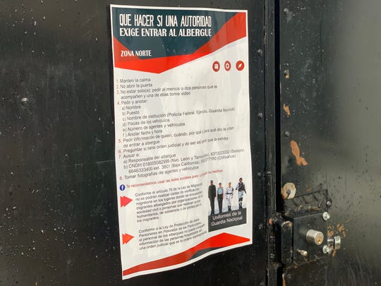 The director of the migrant shelter in Agua Prieta, Sonora, placed a poster next to the entrance, explaining what to do if Mexico's National Guard tries to force its way once again into the shelter to conduct immigration inspections on migrants staying there.