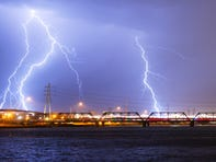 Lightning strikes over Tempe Town Lake during a monsoon storm August 28, 2019.
