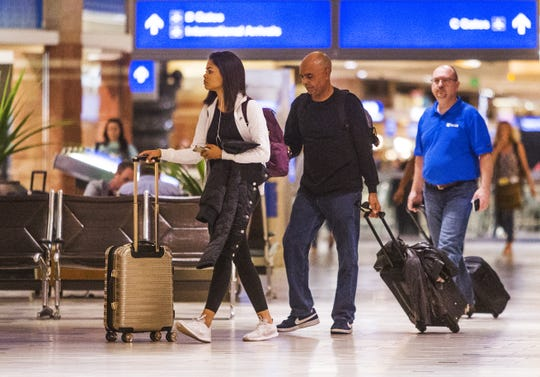 Travelers make their way through the concourse in Terminal 4 at Sky Harbor International Airport on Oct. 31, 2018.