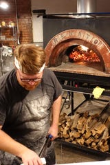 Myke Olsen makes pizza and tends the wood-fired oven at Myke's Pizza in Mesa.