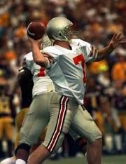Joe Germaine throws a touchdown pass to Dimitrious Stanley for an Ohio State touchdown against Arizona State at the Rose Bowl on Jan. 1, 1997.