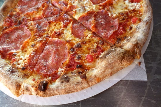 Salami pizza with crushed tomatoes, mozzarella, aged Gouda and spicy honey at Myke's Pizza in Mesa.