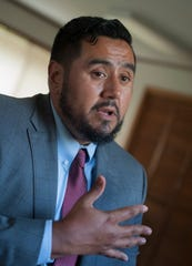 Ray Ybarra Maldonado, a Phoenix attorney specializing in immigration law, sits in the community room of St. Michael's Catholic Church in Forest, Mississippi, Aug. 28, 2019, speaking with family members of those who have been detained by U.S. Immigration and Customs Enforcement in the in the Aug. 7, 2019, raids in the state.