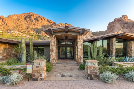 Scott and Jane Wilson paid $3.33 million for this estate in Paradise Valley near the base of Camelback Mountain.