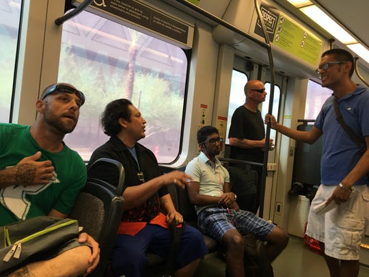 The conversations ranged from tattoos to football on the light rail from Tempe to Phoenix on Wednesday, Aug. 28, 2019.