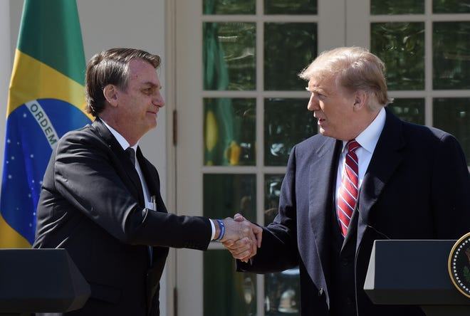 US President Donald Trump shakes hands with Brazilian President Jair Bolsonaro during a joint news conference in the Rose Garden at the White House Tuesday, March 19, 2019 in Washington, D.C. (Olivier Douliery/Abaca Press/TNS)