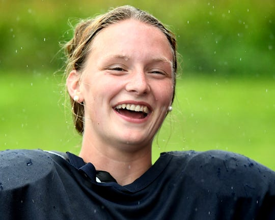 Eastern York girls' soccer player Liz Heistand talks about kicking styles during a football practice at the school Wednesday, Aug. 28, 2019. She is the kicker for the football team. Bill Kalina photo