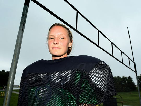 Eastern York girls' soccer player Liz Heistand stands by a goalpost on a practice field at the school Wednesday, Aug. 28, 2019. She is the kicker for the football team there. Bill Kalina photo