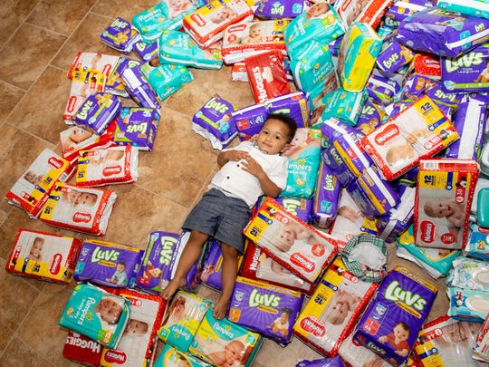 Lucas enjoys the mountain of donations before they're given away at the baby shower, August 24, 2019.