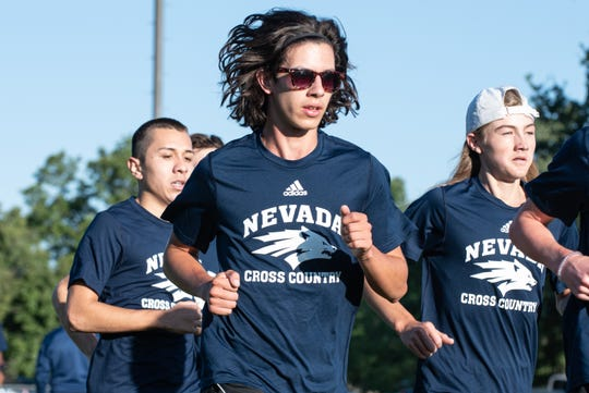 Alex Mendoza, Celime Garcia and George Skivington are n the Wolf Pack men's cross country team.