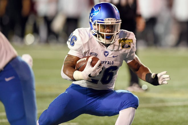 Buffalo Bulls running back Jaret Patterson (26) carries for a touchdown against the Troy Trojans during the first quarter in the 2018 Dollar General Bowl at Ladd-Peebles Stadium in Mobile, Alabama.