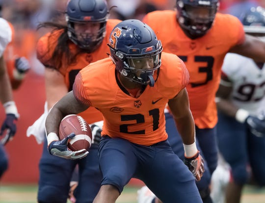 Syracuse running back Moe Neal runs with the ball against the Connecticut Huskies during a 51-21 win over Connecticut last season
