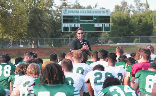Shasta College head football coach Bryon Hamilton talks to his players at the end of practice on Aug. 28, 2019.