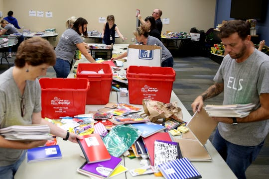 Financial problems have prompted the dissolution of the Salem-Keizer Education Foundation. Here, volunteers sort school supplies for the organization's school supply drive for families in need at NW Natural in Salem on Aug. 29, 2019.