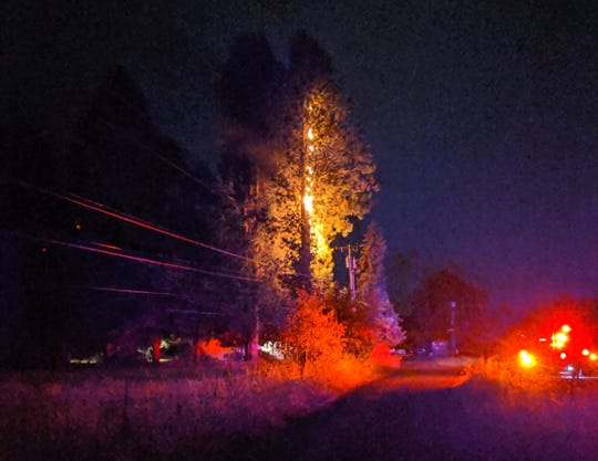 A fire believed to be ignited by lightning on Carmel Drive SE, east of Salem, early Thursday morning.