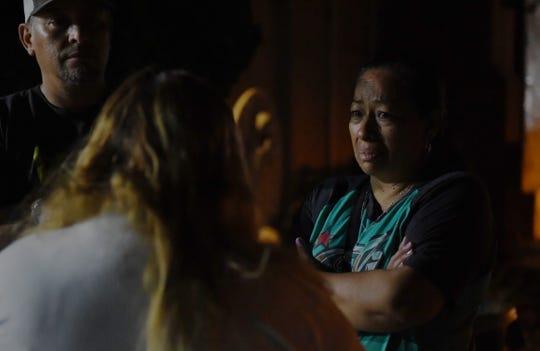 A mourner speaks with Lorena de Salazar, Keyla's mother, after the ceremony. Aug. 28, 2019.