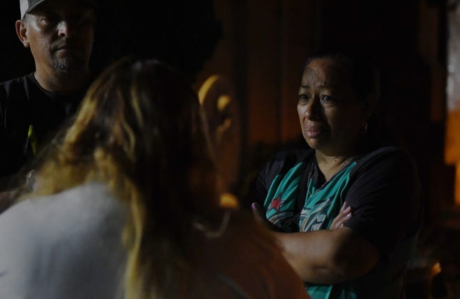 A mourner speaks with Lorena de Salazar, Keyla's mother, after the ceremony. Aug. 28, 2019.