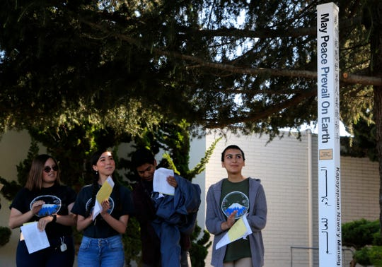 (From left:) Meagan Morales, Mark Zarate, Alyssa Powell, and Bryanna Mendez, all 18, applaud the unveiling of the Peace Pole, which was unveiled Tuesday afternoon at Salinas City Hall. They were part of the Salinas Union High School District's Japanese Program, which last year came up with the Peace Pole idea while visiting Okinawa.