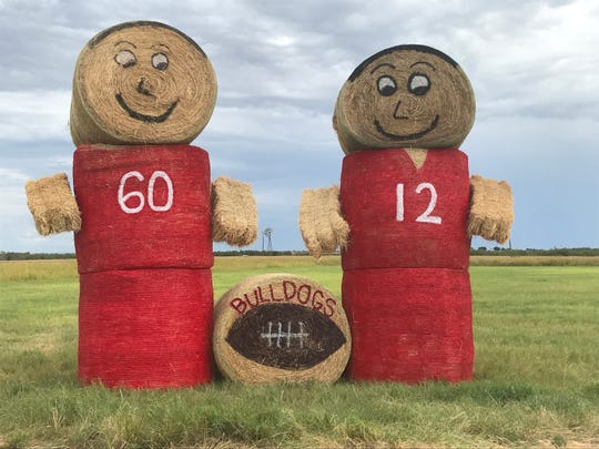Located off US Highway 67 between Miles and Rowena, a high school football fan shows their support for the Miles Bulldogs with these decorated bales of hay. Miles, along with hundreds of other schools across Texas, kicks off its season Friday, Aug. 30, 2019.