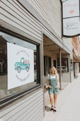 Owner Katie Luttmann stands in front of the new Mason Jar Boutique & Floral on Dell Rapids' main street.