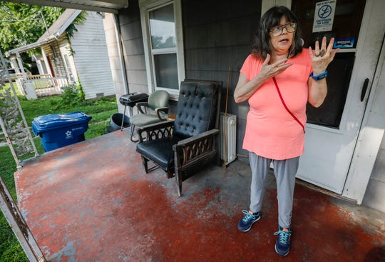 """Kathy Lutz, the president of the Grant Beach Neighborhood Association, talks about the home that is next to hers that is vacant and has been declared a """"dangerous building."""""""