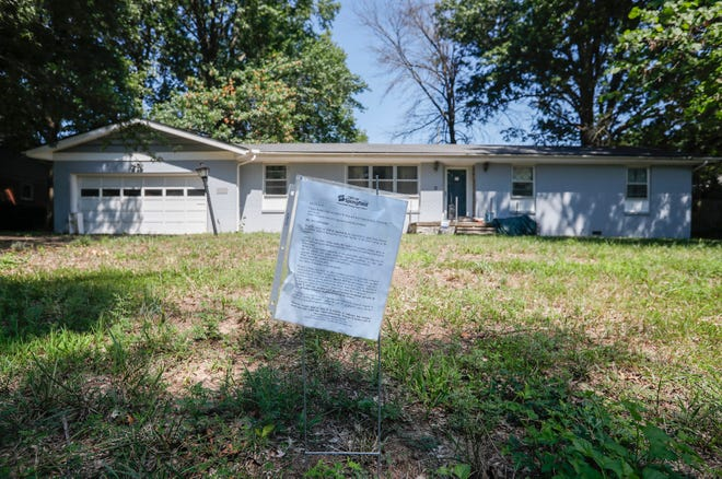 The city of Springfield has posted an abatement notice and order to this home on East Amidon Street informing the owner they must remove rubbish and debris as well as downed limbs and brush piles from the property.