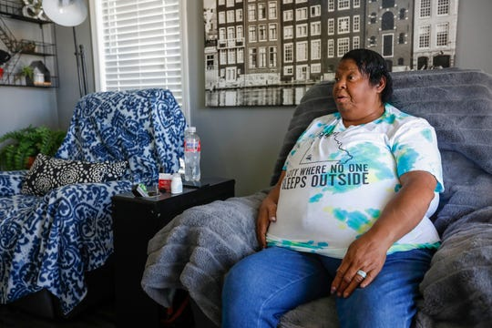 Eden Village resident Teresa Ross talks about how much she enjoys living in the tiny home community on Wednesday, Aug. 28, 2019, in Springfield, Mo.