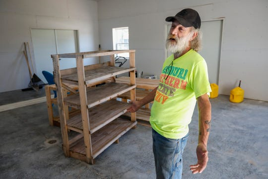 Eden Village resident Gil Rife talks about the new workshop being built at the tiny home community on Wednesday, Aug. 28, 2019, in Springfield, Mo.