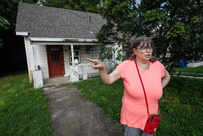 "Kathy Lutz, the president of the Grant Beach Neighborhood Association, talks about the home that is next to hers that is vacant and has been declared a ""dangerous building."""