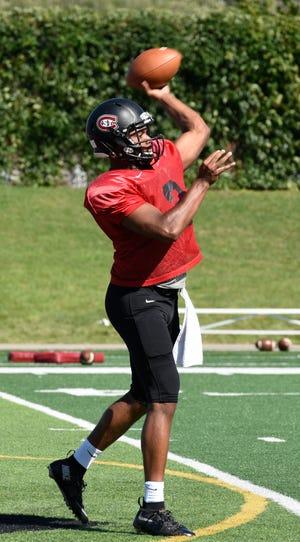 Senior quarterback Dwayne Lawhorn throws during practice Wednesday, Aug. 28, 2019, at Husky Stadium. This will be his third year as the starting quarterback.