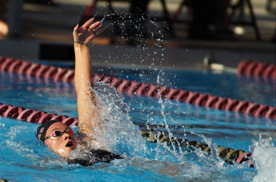 Chiles sophomore Lydia Hanlon backstrokes during a high school swim meet at FSU's Morcom Aquatics Center on Wednesday, Aug. 28, 2019.
