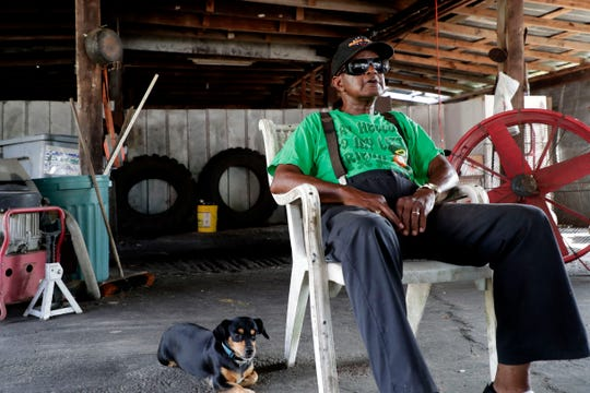 """Winston Hall, 83, sits on his property as he shares his experience with Hurricane Michael and the road to recovery for his community of Bristol, Fla. Michael struck the Panhandle in Oct. 2018. """"I've seen some hurricanes in my life, but I never seen one like this before."""""""
