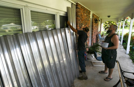 Richard Hensen and his uncle Peter Henson, prepare their grandmothers house, on Thursday, Aug. 29, 2019, where they live on Greenwood Drive in Fort Pierce, for the arrival of Hurricane Dorian.