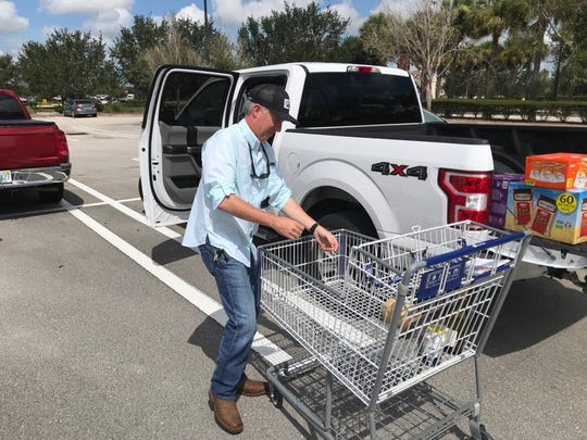 "At a Sam's Club, it seemed like almost every customer had packs of water in their shopping carts Aug. 29. Lines stretched to reach fuel pumps. Lines stretched for water.   ""You got to take it seriously,"" said Clem Foley, 45, who was loading up a pickup with supplies at Sam's Club."