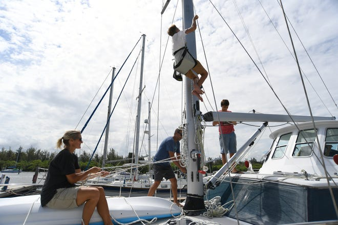 The Vero Beach City Council agreed Tuesday to move forward with a major expansion and renovation project at the Vero Beach City Marina. In this photo taken Aug. 29, 2019, the Lytle family works to prepare their 47-foot Gulf Star Sailmaster sailboat at the marina in preparation for Hurricane Dorian.