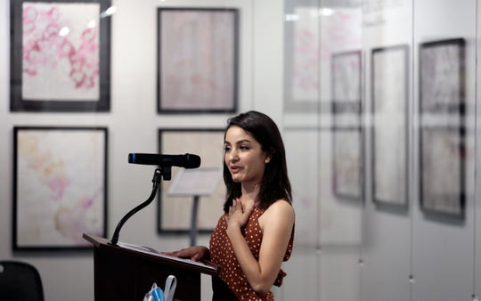 Artist Brendda Gonzalez talks about her work Thursday, Aug. 29, 2019, as the Art Windows of El Paso Gallery opens a new exhibit at the airport. Her art depicts how emotion feels on the inside of the body.