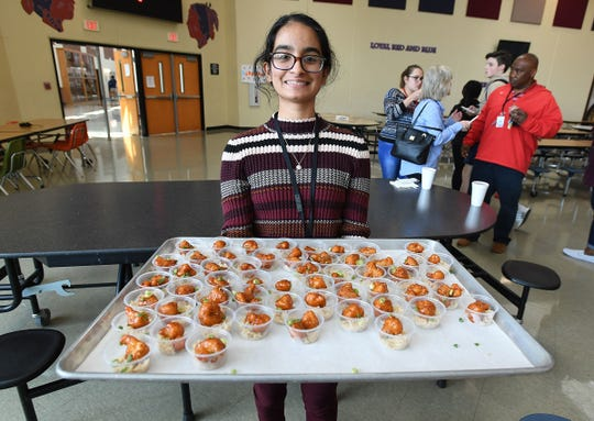 Riverside sophomore Nayha Hussain, who was the 2017 Healthy Lunchtime Throwdown winner, holds samples of her winning dish, Gobi Manchurian, during lunch at Riverside on Tuesday, April 10, 2018.
