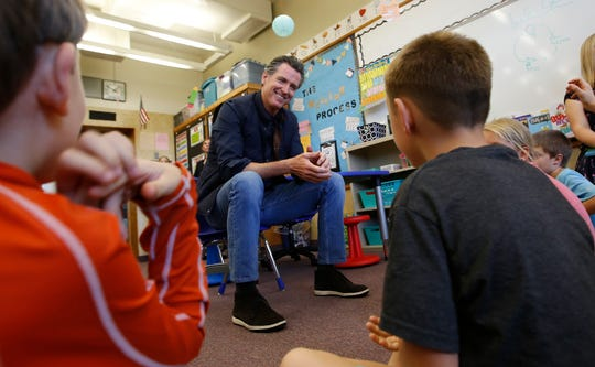 In this photo from last week, Gov. Gavin Newsom takes questions from second graders during his visit to the Paradise Ridge Elementary School in Paradise. California is poised to overhaul how it authorizes and judges charter schools in what the governor's office is calling the most significant update in decades.