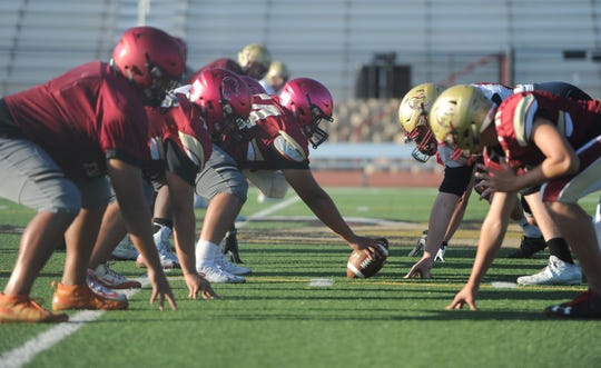 The offensive and defensive lines of the Oaks Christian football team go helmet to helmet during Wednesday's practice. The Lions host Grace Brethren on Friday night in a showdown of two local powerhouse programs.