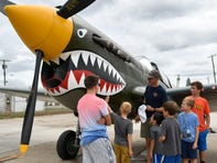 A crowd gathers at the P-40 Warhawk, one of the planes featured during the Wings of Freedom tour at The Millville Army Air Field Museum.