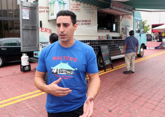 Gene-Christian Baca, of Walter's Hot Dogs,  talks about hiring summer workers while outside his food truck at the White Plains Farmers Market Aug. 28 2019.