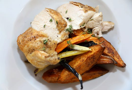 Chicken with sweet potatoes and roasted carrots at Hudson Social in Dobbs Ferry.