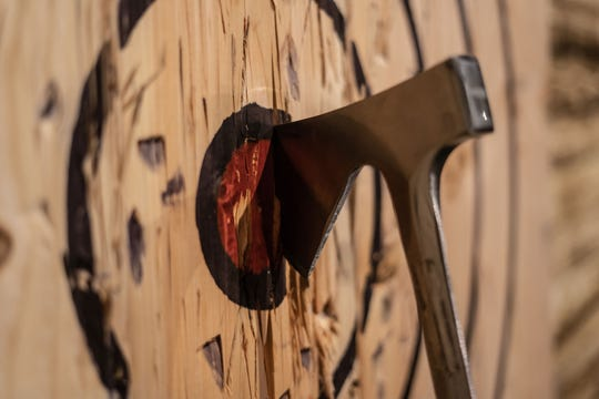 An ax sits in a target at Bad Axe Throwing.