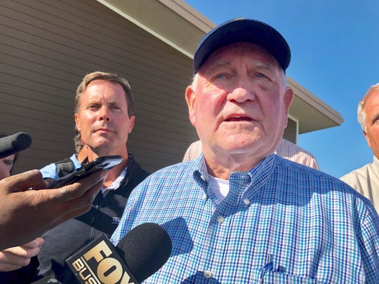 U.S. Agriculture Secretary Sonny Perdue speaks to reporters at an Ag Policy Summit during a visit Wednesday, Aug. 28, 2019 to Decatur, Ill. Perdue has sought to assuage farmers' fears of financial problems after China halted purchases of U.S. farm products in an escalating trade war. (AP Photo/John O'Connor)
