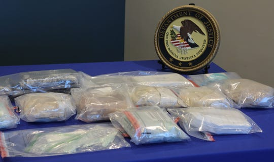 Some of the drugs seized by law enforcement in Delaware.  Two men were arrested for selling fake Oxycodone pills, heroin, cocaine and cash.